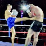A perfect Roundhouse kick finds its target on the opponent