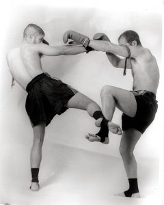 Two Muay Thai opponents display strength and balance